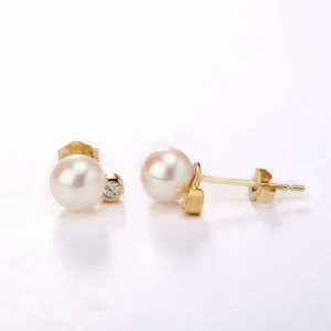 white pearls and diamond earrings