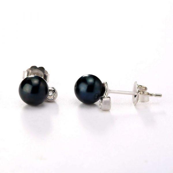 black pearls and diamond earrings