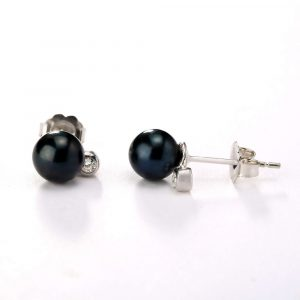 black pearls and diamond earrings